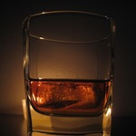 Thumb a glass of whiskey